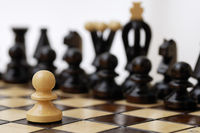 One pawn standing up to a stronger opponent.