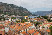 Beautiful top view of the old town of Kotor, Montenegro. Orange tiled roofs of houses from above.