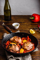 Chicken thighs with red bell peppers and lemon
