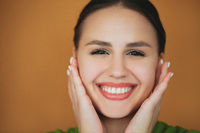 Delighted brunette woman laughing in studio