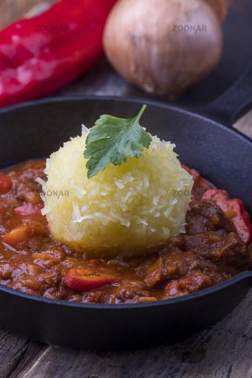Hungarian goulash in an iron pan