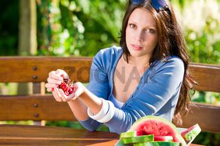 Fresh cherries melon woman garden summer terrace