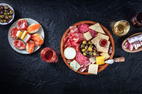 Charcuterie and cheese board, overhead flat lay composition with copy space