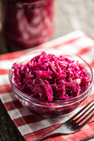 Red sauerkraut. Sour pickled cabbage in bowl.