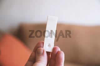 hand holding corona covid-19 rapid antigen self test showing negativ result