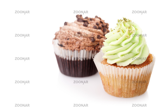 two cupcakes with cream isolated on white