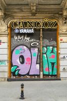 Closed shop exterior with metal door covered with colorful graffiti , Istanbul, Turkey