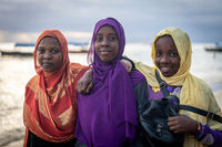 Group of Muslim girls together on beach