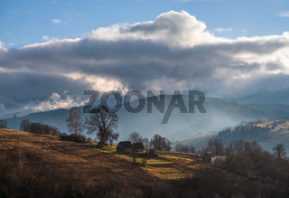 Picturesque morning above late autumn mountain countryside.  Ukraine, Carpathian Mountains. Peaceful traveling, seasonal, nature and countryside beauty concept scene.
