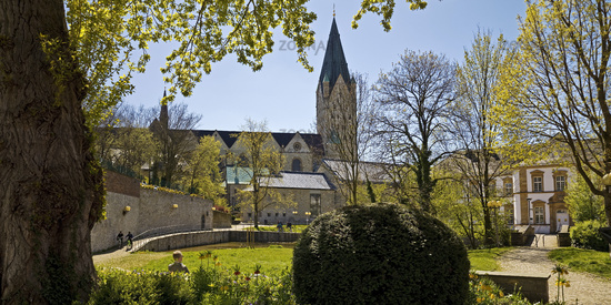 Green area with Pader spring and cathedral in spring, Paderborn, Germany, Europe