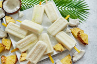 Homemade vegan popsicles made with coconut milk and pineapple. Delicious healthy summer snack