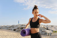 The concept of a healthy lifestyle. Sporty and happy woman doing workout.
