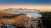 sunrise with fog by the pond below the Tatras