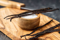 Vanilla pods. Sticks of vanilla and white sugar