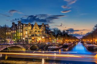 Amsterdam Netherlands, night city skyline of Dutch house at canal waterfront