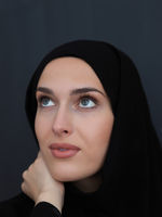 Portrait of modern young muslim woman in black abaya