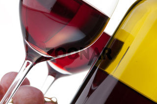 Two glasses with dark red wine on a white background