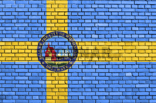 flag of Wilmington, Delaware painted on brick wall