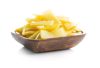 Sliced canned bamboo shoots in wooden bowl.