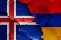 flags of Iceland and Armenia painted on cracked wall