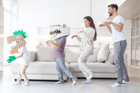 Family playing dinosaurs at home