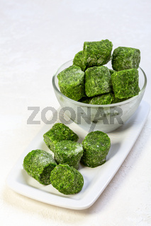 Frozen spinach in briquettes.