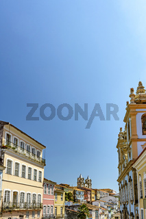 Facade of old, historical and colorful houses and churches in the Pelourinho