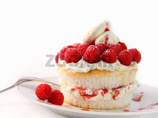 Raspberry and whip cream cupcakes on white