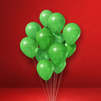 Green balloons bunch on a red wall background