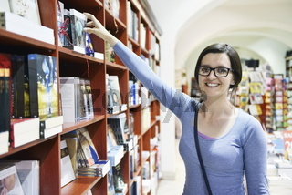 female in library