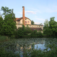 Schoenau, old factory in Wetzikon, Zurich. Beautiful old chimney with a storks nest on top.