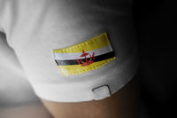 Patch of the national flag of the Brunei on a white t-shirt