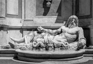 Famous Greek sculpture of Ocean god, named Marforio, located in Rome, Italy. Classic mythology in art.