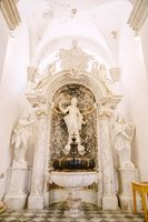Dubrovnik, Croatia - 04 may 2016: Church of the Vlaha Church inside, in Dubrovnik, Croatia, Europe. A large marble font surrounded by statues and columns.