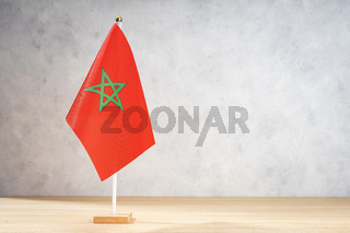 Morocco table flag on white textured wall. Copy space for text, designs or drawings
