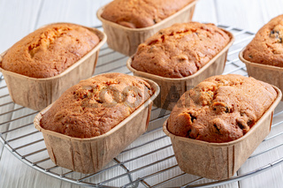Freshly baked mini loaves of cupcakes with raisins.