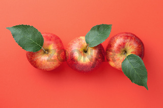 Red Apples With Leaves Over Paper Background