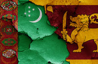 flags of Turkmenistan and Sri Lanka painted on cracked wall