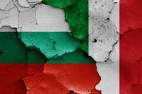 flags of Bulgaria and Italy painted on cracked wall
