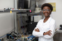 Scientist african american woman working in laboratory with electronic instruments
