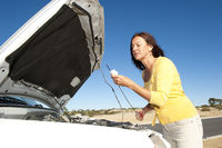 Woman checking oil car
