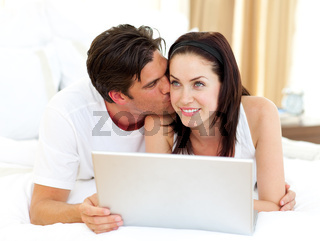 Lovers using laptop