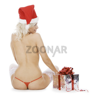 Wonderful female in santa hat and white stockings near Christmas gif