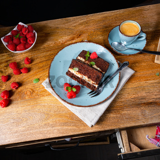 Rustic chocolate cake with raspberries and coffee