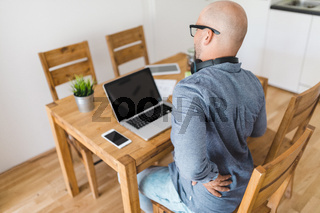 Man working from home during the coronavirus Covid 19 pandemic