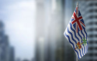 A small flag of British Indian Ocean Territory on the background of a blurred background
