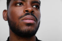 Cropped image of focused millennial african american young serious black man.