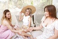 Crop women drinking wine during picnic