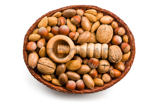 wooden nutcracker and nuts in basket