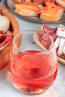 Rose wine with ham, cheese, and salmon sandwiches. Spanish tapas in a bar
